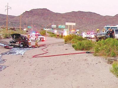 Golden Valley Fire Department/Courtesy<br> Responders work the scene of a two-car accident in which a toddler and adult were killed Sunday.