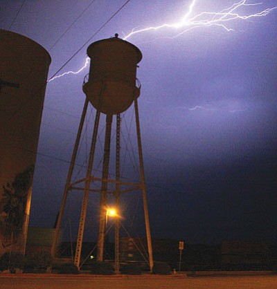 JC AMBERLYN/Miner<br /><br /><!-- 1upcrlf2 -->Lightning flashes over the water tower in downtown Kingman one August night.
