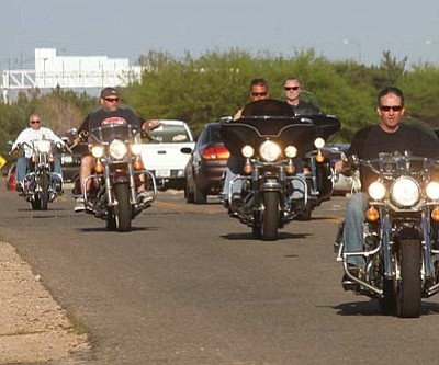 Motorcyclists ride at the event Friday.