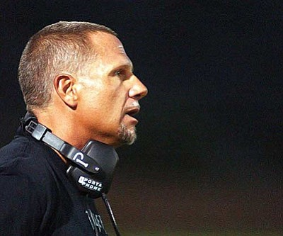 RODNEY HAAS/Miner <br /><br /><!-- 1upcrlf2 -->Former Kingman Academy football coach Eugene Kramer looks over the field during a Tigers' game last fall. Kramer stepped down as head football coach at KAHS to take over as football coach at Lee Williams High School in the fall.