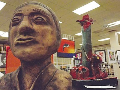 AHRON SHERMAN/Miner<br> There's no shortage of creativity here, as two 3-D pieces sit in front of several 2-D works.