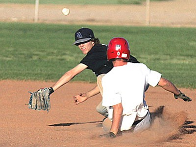 RODNEY HAAS/Miner<br>  KAHS Black's Austin Tomlinson eyes the throw from the catcher as a Desert Hills runner steals second base during Black's win on April 20. Black secured the No. 1 seed in the 3A CAA playoffs and will host West Phoenix in the opening round at 5:30 p.m. today at Southside Park.