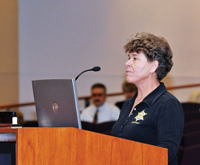 BUTCH MERIWETHER/Miner<br /><br /><!-- 1upcrlf2 -->Cerbat Constable Jean Bishop at Monday's meeting of the supervisors.