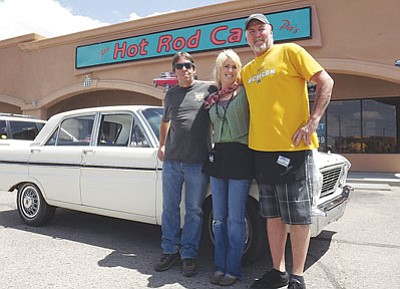 "AHRON SHERMAN/Miner<br /><br /><!-- 1upcrlf2 -->Kirk Slack (far left) stands with Hot Rod Café part owners Mark and Julie Burak in front of Slack's 1965 white Ford Falcon, which has a prominent role in ""Secrets of the Desert.""<br /><br /><!-- 1upcrlf2 -->"