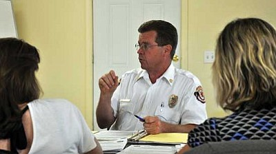 Butch Meriwether/Miner<br /><br /><!-- 1upcrlf2 -->Golden Valley Fire Chief Tom O'Donohue responds to questions from the fire board of directors during the fire district's May 9 meeting in which various agenda items were discussed and voted on.