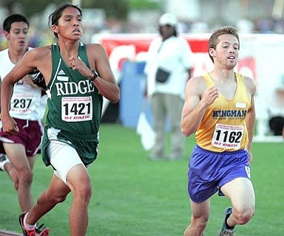RODNEY HAAS/Miner<br /><br /><!-- 1upcrlf2 -->Kingman High's David Haun (left) competes in the boys 800 meters Friday at the Division I State Track Meet at Mesa Community College in Mesa.