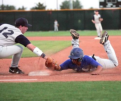 RODNEY HAAS/Miner<br /><br /><!-- 1upcrlf2 -->KAHS Blue's Josh Van Vliet dives safely back to first base during a pickoff attempt in Blue's 8-2 win over EVAC during the 3A Charter Athletic Association tournament Thursday at Salt River Fields in Scottsdale. With the win, Blue advanced to Saturday's championship game with KAHS Black. <br /><br /><!-- 1upcrlf2 --><br /><br /><!-- 1upcrlf2 -->