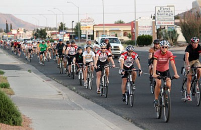 JC AMBERLYN/Miner<br /><br /><!-- 1upcrlf2 -->Bicyclists ride up Stockon Hill Road during the 2009 Ride of Silence. This year's event will start at 7 p.m.  today at Kingman Academy Middle School, 3269 Harrison St.