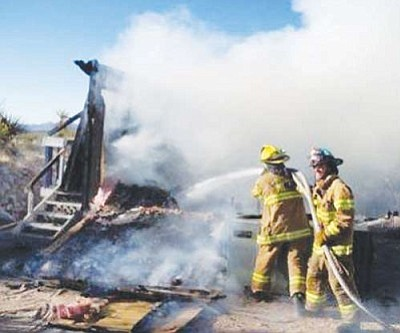 Lake Mohave Ranchos Fire Department/Courtesy<br /><br /><!-- 1upcrlf2 -->Firefighters put out a recent blaze. Last month, the Lake Mohave Ranchos Fire Department responded to 18 fire calls.