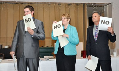 Butch Meriwether/Courtesy<br /><br /><!-- 1upcrlf2 -->Candidates for Mohave County's Arizona House of Representatives seat respond to a lightning round of questions during Monday's Republican Men's Club. Pictured from left are George Schnittgrund, incumbent Doris Goodale and Sonny Borrelli.<br /><br /><!-- 1upcrlf2 -->