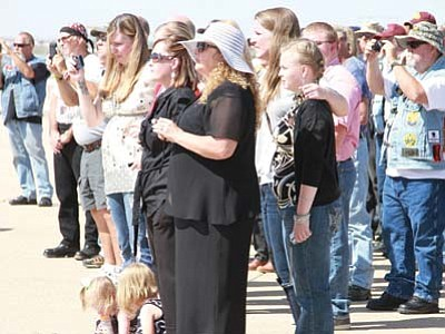 JC AMBERLYN/Miner<br> Family and veterans wait at the Kingman Airport Thursday for the body of Army Sgt. Brian Walker.