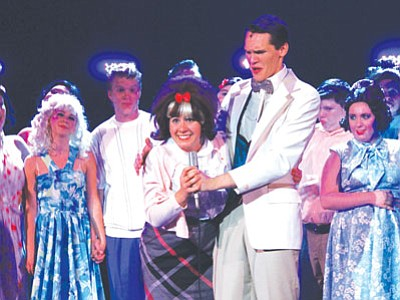 "Courtesy<br> Clad in a pink cardigan and a beehive as big as her smile, former Kingman Academy of Learning student Alexa Russo takes center stage during a production of ""Hairspray"" by students at Los Angeles County High School for the Arts."