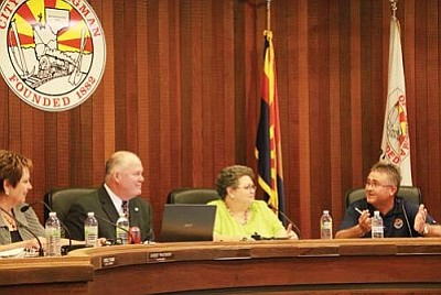 JC AMBERLYN/Miner<br /><br /><!-- 1upcrlf2 -->Councilwoman Janet Watson, Mayor John Salem and former Vice Mayor Robin Gordon look on as former Councilman Keith Walker says farewell.<br /><br /><!-- 1upcrlf2 --><br /><br /><!-- 1upcrlf2 -->