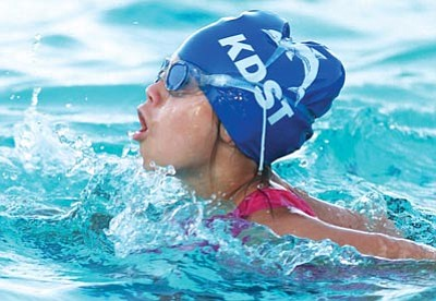 JC AMBERLYN/Miner<br> Amelia Brackett works on her breaststroke during the Kingman Dolphins' annual Swim-O-Rama fundraiser Tuesday at Centennial Park pool.