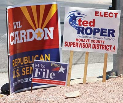 JC AMBERLYN/Miner<br> Campaign signs at the corner of Stockton Hill Road and Andy Devine Avenue Friday.