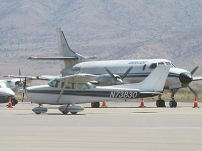 JC AMBERLYN/Miner<br> A plane taxis down a runway Friday morning at the Kingman Airport.