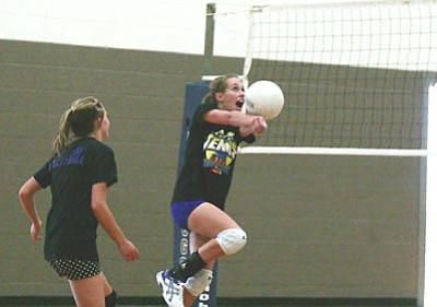 RODNEY HAAS/Miner<br> Gabby Huffer returns a volley during open gym Tuesday at Kingman High School. The KHS volleyball team has been holding open gym since the start of June and members are currently competing at Arizona State University. The Lady Bulldogs will hold a volleyball camp July 30-Aug. 2 and open tryouts beginning Aug. 6.