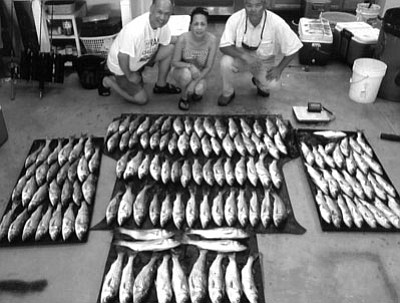 DON MARTIN/For the Miner<br /><br /><!-- 1upcrlf2 -->This is the catch that the Lee family brought in during a trip on Saturday night with Outdoors writer and guide Don Martin. The foursome caught 133 fish.  From left, Kensen Lee, Ruby Lee and Jay Chan.