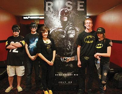 """JC AMBERLYN/Miner<br> A sold-out crowd was at Brenden Theaters before midnight Thursday to see the new Batman movie, """"The Dark Knight Rises."""" Pictured from left to right are some who dressed for the occasion: David Greene, Anthony Vanrees, Isabel Nava, Seth Cunningham and Julie Kremenak."""