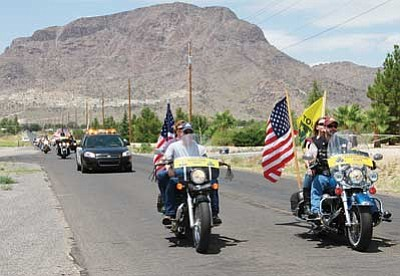 JC AMBERLYN/Miner<br> PGR members ride out of Mohave Community College-Kingman Saturday morning.