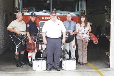 KFD/Courtesy<br> Pictured left to right are Kingman bagpiper Fred Warring, Calgary Pipe Band member Terry Clark, Kingman Fire Chief Chuck Osterman, Kingman bagpiper Jim Glover and piping student Stacy McDaniels.