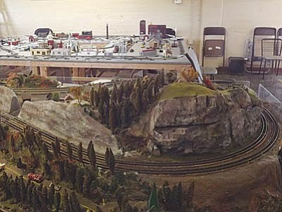 AHRON SHERMAN/Miner<br> Two of the railroad museum's displays are nearly done. The N-scale display (foreground) still needs some landscaping work while the O-scale display (background) needs a mountain in the middle and landscape work as well.