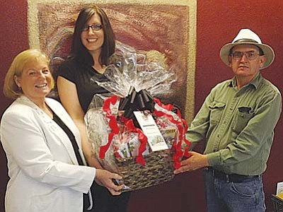 AHRON SHERMAN/Miner<br> Councilwoman Carole Young, KABAM co-organizer Kristi Turman and local Route 66 author and historian Jim Hinckley show off the community-prepared Route 66 gift basket to be given away at the October Route 66 Cuba Fest in Cuba, Mo.