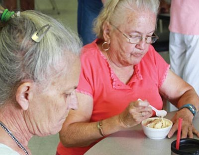 JC AMBERLYN/Miner<br> Patricia Adair (left) and Kathy May enjoy their ice cream.