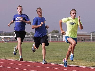 RODNEY HAAS/Miner<br> KHS's Patrick Webb leads the pack with Preston Hammond and Shaun Wooten following close behind Tuesday afternoon. All three runners are expected to help lead the Bulldog cross country team this year.