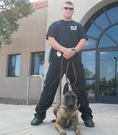 ERIN TAYLOR/Miner<br /><br /><!-- 1upcrlf2 -->Officer Adam Parrot and Sam, the Kingman Police Department's first K9.