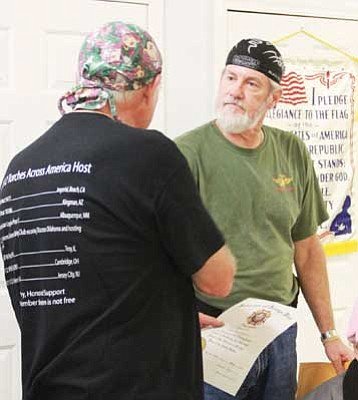 JC AMBERLYN/Miner<br /><br /><!-- 1upcrlf2 -->Torches Across America rider Gary Covert (left) and Mike Breighner, House Committee vice chairman of VFW Post 10386, shake hands during a brief ceremony of thanks Tuesday at the VFW Post.