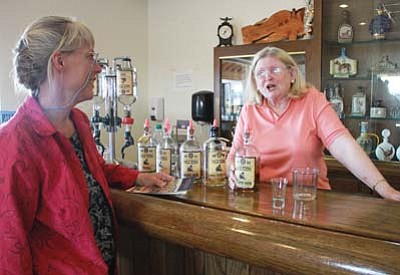 JC AMBERLYN/Miner<br> Marianne Van Hasselt (left), tour member, talks to Marianne Patt, wife of the co-owner of Desert Diamond Distillery, during the first Kingman to Seligman Legendary Route 66 Adventure Tour Saturday. The event was hosted by El Trovatore Motel.