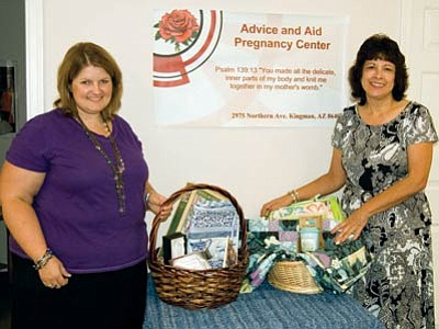 SUZANNE ADAMS-OCKRASSA/Miner<br> Jill Bender (left) and  Advice and Aid Pregnancy Center Director Teresa Reaume show off gift baskets that will be raffled Oct. 20 at the center's benefit tea at Metcalfe Park.