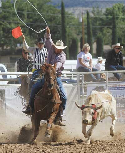 JC AMBERLYN/Miner<br> The 2011 Andy Devine Days Rodeo was held at the Mohave County Fairgrounds. The team of Rube Woolsey and Tom Johnson participated in the team roping event.