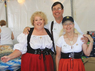 Mary K. Clark (left), Shawn Savage and Jo Ann Oxsen got in costume for the Fourth Annual Oktoberfest in downtown Kingman in 2011.