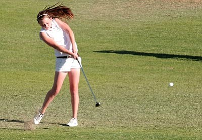 DAVID BELL/Today¹s News-Herald<br> Kingman's Mariah Sammeli hits her approach from the fairway of No. 6 of the Nassau Course during Thursday¹s match against Lake Havasu, San Luis and Yuma Kofa, at the Courses at London Bridge Golf Club, in Lake Havasu City. Sammeli and Bekah Van Kirk led the Lady Bulldogs with a 47 each and Kingman finished second to Lake Havasu by five strokes.