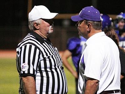 RODNEY HAAS/Miner<br>  Former Kingman Academy football coach Doug Odum and referee John Hicks talk during the Tigers' 60-0 win over Desert Hills on Sept. 1. Odum resigned as head football coach Monday.