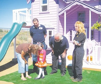 ERIN TAYLOR/Miner<br /><br /><!-- 1upcrlf2 -->Michael Martinez, David Fransen (kneeling) and Kit Kenney of Speedco meet with Emmalynn Faris and her mom, Crystal. Speedco's financial donation to the Make-A-Wish Foundation of Arizona made the project possible.