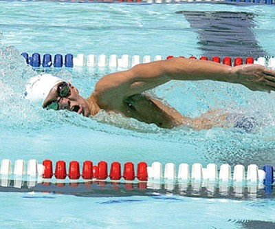 RODNEY HAAS/Miner<br /><br /><!-- 1upcrlf2 -->Patrick Webb swims in a freestyle heat for the Kingman Dolphins during the Arizona regional meet back in July. <br /><br /><!-- 1upcrlf2 --><br /><br /><!-- 1upcrlf2 -->