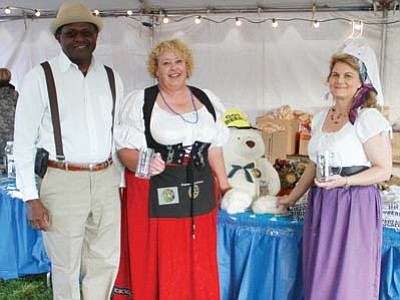 JC AMBERLYN/Miner<br> From left to right, Fred Gilbert, Patty Hlavac and Mary K. Clark pose in costume Friday evening.