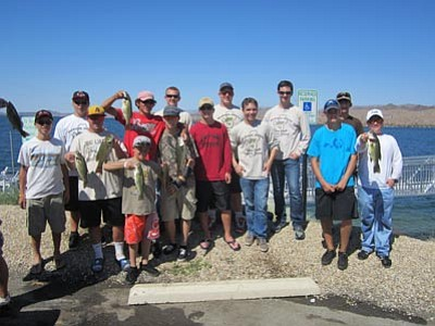 Special to the Miner<br> Members of the Mohave Junior Bass Club gathered for a group photo while fishing at a recent bass tournament at Lake Havasu. Special to the Miner Members of the Mohave Junior Bass Club gathered for a group photo while fishing at a recent bass tournament at Lake Havasu.