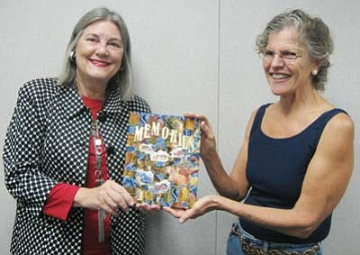 "Courtesy<br> Pictured from left are Danielle Krol, Mohave County Library District director, and  Beth Swider, creator of ""Memories from A to Z."" It will be used as the cover art for a new Mohave County Oral History Collection being compiled by Mohave County Library."