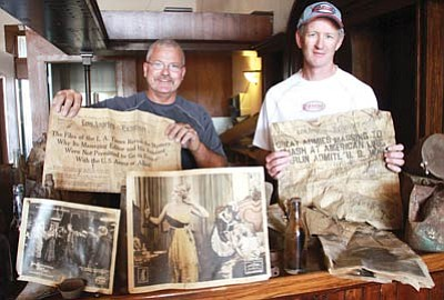 JC AMBERLYN/Miner<br> Robbie Wright and Kevin Morgan of Axiom Remodeling display some of the items found during demolition work.