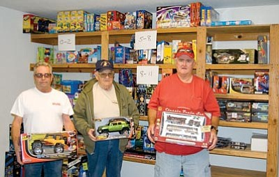 SUZANNE ADAMS- OCKRASSA/Miner<br> From left, Toys for Tots coordinator Don Olin and Marine Corps League members Ben Leitgh and Warren Brocknan pose with some of the toys they have already collected or purchased for this year's Toys for Tots campaign.