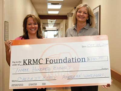 Charity Faucher, left, presents a check to Teri Williams of KRMC.