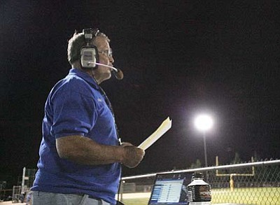 Harry Hoyler broadcasts the Kingman Academy-Peoria Accelerated football game on www.KKAYsports.com in September from the back of his 1988 Ford F-150 pickup. This is the first year Hoyler has broadcast Tigers football games, and he hopes to continue his partnership with the school this winter and spring with basketball and baseball games.<br /><br /><!-- 1upcrlf2 --><br /><br /><!-- 1upcrlf2 -->RODNEY HAAS/Miner