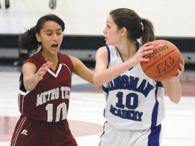 JC AMBERLYN/Miner<br> Leanna Carley gets ready to make a move for Kingman Academy during Tuesday's game.