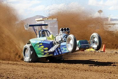 JOHN KIRBY/Courtesy<br> Nick Schultzman sends dirt flying as he takes off at the Fast Track Racing Sand Drags event Nov. 16 – 18. The race was held north of town on a piece of property owned by the Lingenfelter family. The County Planning and Zoning Commission recommended approval of a zoning use permit at its Nov. 14 meeting. The Board of Supervisors will take up the issue at its Dec. 3 meeting.