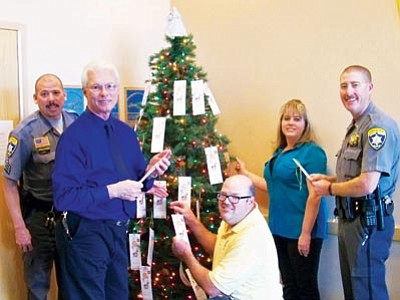Courtesy<br> The Mohave County Sheriff's Office's 2012 Angel Tree. From left, Sgt. Stephen Padilla, Chief Deputy Jim McCabe, Salvation Army Service Center Director Bill Ward, Office Clerk Laura Woodward and Lieutenant Dean McKie.