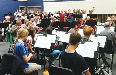 Courtesy<br> The Mohave Community Choir and the Mohave Community Orchestra rehearse for their Saturday Christmas show at Kingman High.